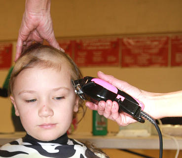 Landon Knopp, 6, stays cool during his haircut.