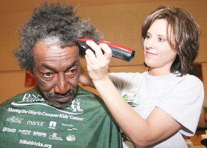 Joe Downs had his head shaved for the second time this year to honor his brother. Sherry Moore gave Downs his haircut.