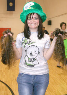 Taylor Claypool holds the ponytails that were collected as donations for Locks of Love during this year's event. Locks of Love uses the hair to make wigs for people going through chemotherapy.