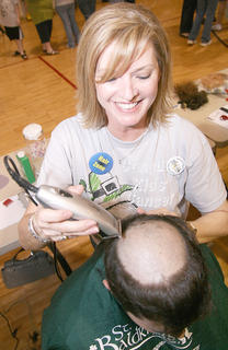 Eileen Hughes had a little fun with Jonathan Livers before cutting off all of his hair. Livers was one of the 105 shavees who raised nearly $26,000 for the St. Baldrick's Foundation, which provides grants for research to fight children's cancer.