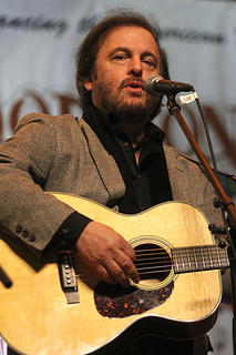 Michael Johnathan, host of the Woodsongs Old-Time Radio Hour, performs a pair of songs Saturday evening.