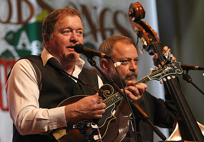 Lou Reid, left, sings and plays mandolin for Seldom Scene. Bass player Ronnie Simpkins is on the right.