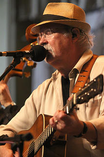Dudley Connell sings and plays guitar for Seldom Scene during the Saturday dinner show at the 2016 Kentucky Bluegrass Music Kickoff.