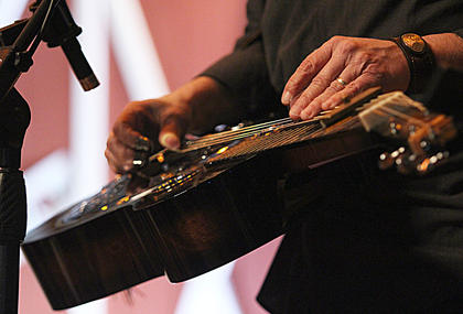 Fred Travers of Seldom Scene slides his hands along the dobro strings Saturday evening.