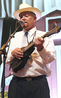 """Deacon Joe Dant sings lead vocals on """"'52 Vincent Black Lightning"""" during the Honeysuckle String Band's performance Friday evening."""