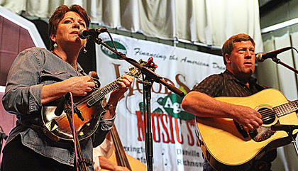 Pam Perry Combs and Larry Rains share vocal duties for Dove Creek on Friday evening.