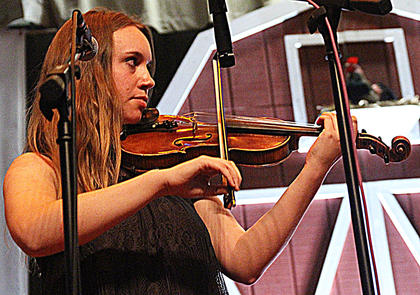 Ellie Ruth plays fiddle with the Blue Belles on Friday night.