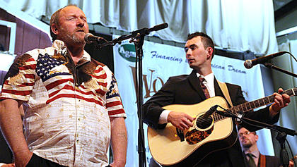 "Tim Smith sings ""Go Rest High On That Mountain"" accompanied by Buddy Robertson on guitar during a jam session at the end of Friday evening's show."