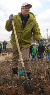 David Kessler, a Campbellsville University biology professor, digs a hole for one of the seedlings Sunday afternoon.