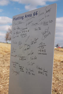 Volunteers were asked to write their names on signs near the area where they planted trees.