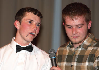 Brady Spalding, left, and Matthew Newcome perform a ventriloquism routine during the talent portion of the competition.