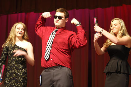 Jerod Marrett performs a modeling routine during the talent competition. Pictured with Marrett are Madelyn Hagan and Leah Thompson.