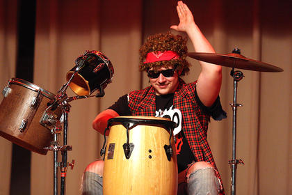 J.P. Redfern plays the drums during the talent portion of the competition.