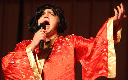 Trevor Fitzpatrick lip synches during the talent portion of the competition.