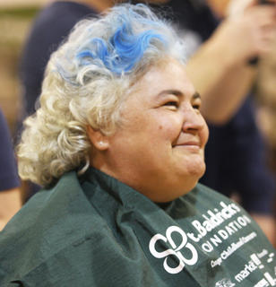 Mary Mattingly was full of expressions while getting her head shaved with the team Casper and the Looneytunes. Mattingly was one of seven siblings who shaved their heads in honor of their sister, Sue Beavers, who is undergoing treatments for non-small cell lung cancer.