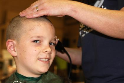 Dalton Dozier, 9, smiles during his haircut.
