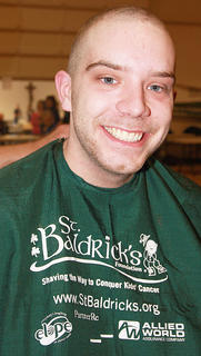 Shawn Medley of the team It's a Family Off-Hair is all smiles after shaving his head for St. Baldrick's. He had been growing his hair for three and half years.