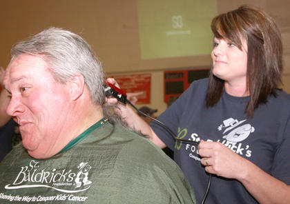 Bill Pickerill appears amused as his head is shaved for St. Baldrick's by stylist Candi Skaggs.