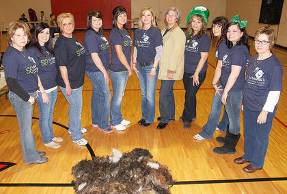 This year's stylists posed with the results of their handiwork at the end of the event. From left, they are Polly Miller, Robyn Wood, Carol Curtsinger, Candi Skaggs, Mindy Garrett, Eileen Hughes, Vickie Childers, Kim Childers, Sarah Fisher, Taylor Claypool and Darlene Morgan. Not pictured: Connie Smith.