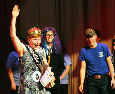 Zachary Mullins, 2019 Junior Mister, waves to the crowd after winning the annual charity pageant. Also pictured is Eli Thomas. The show raised $2,800 for St. Jude's Hospital and the Cystic Fibrosis Foundation.