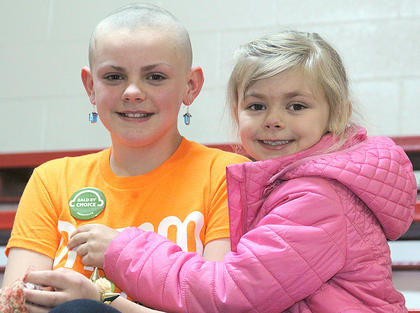 Lilly Clark, 11 (on left) raised $460 for St. Baldrick's by shaving her hair. Her sister, Kaylee, 6, is pictured with her.