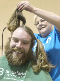 For the second time, Shawn Medley offered his hair and his beard for the sake of children's cancer research. Connie Smith had the honor of removing his hair.