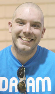 Shawn Medley's head is much lighter without his hair and beard.