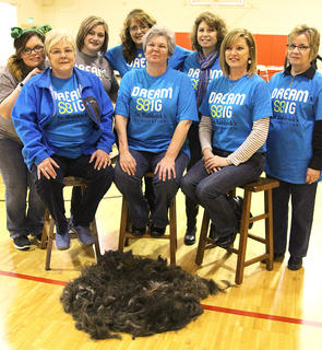 This year's stylists pose for a photo with the results of their labor. Front row (from left): Connie Smith, Vickie Childers and Eileen Hughes. Back row: Taylor Claypool, Tanisha Orberson, Kim Childers, Polly Miller and Darlene Morgan.