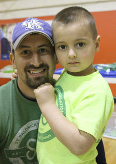 Parker Thompson, right, was last year's St. Baldrick's ambassador child. He is pictured with his uncle Chris Blair. Thompson, who was diagnosed with Stage IV heptoblastoma, a type of liver cancer, has been cancer free since April 29, 2014.