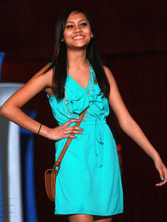 Seventh-grader Hannah Phim models a turquoise dress.