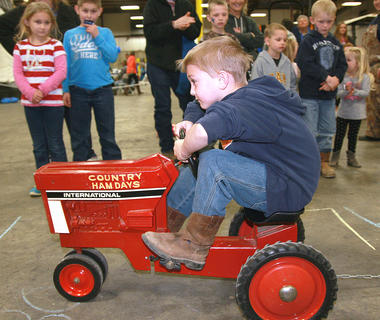 Will Buckman, 7, keeps rolling in the pedal pull contest.