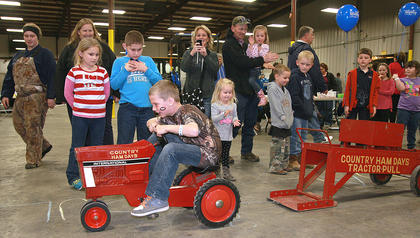 Caden Winkler, 8, tries to push a little more in the pedal pull.