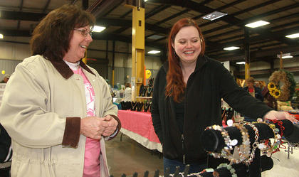 Patty May Brown, right, shows some of her hand-made jewelry to Phyllis Cox.