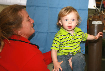 The Marion County Chamber of Commerce hosted it annual Farm, Home and Garden Show over the weekend.  Ethan Coulter, 18 months, of Springfield poses for his Kid Print ID card photo with a little help from his mother, Sandra Coulter