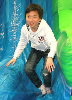 David Guo, 11, enjoyed a slide on one of the many inflatables set up at the Farm, Home and Garden Show.