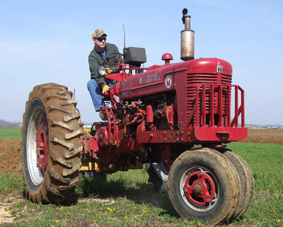 The annual Plow Day was held April 13 at Goodin View Farms. Several local farmers brought some older model tractors along with some antique plows to turn up dirt. Brandon Caldwell takes a Farmall Super M out for a spin.