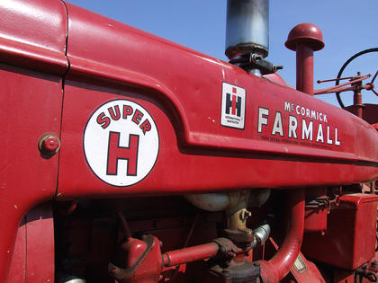 This Farmall Super H shows that the farmers like to keep their equipment in good, running condition.