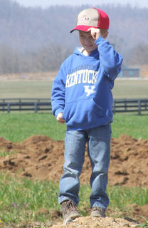 Lane Buckman 5, either climbed a mound of dirt for a better view or to pose for photos.