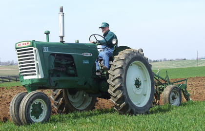 """Tommy Beavers drove his 1958 Oliver 770, which he said was the """"right"""" shade of green."""