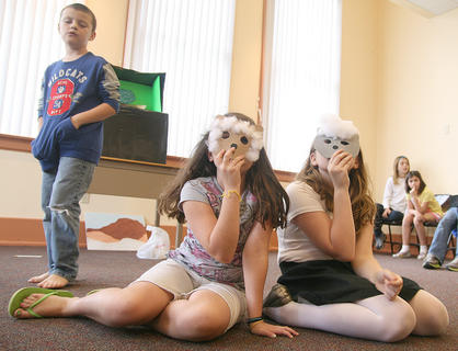 "Russ Smothers (as Peter in ""The Boy Who Cried Wolf"") rehearses watching over his sheep, Emma Humphress and Savannah Chapman."