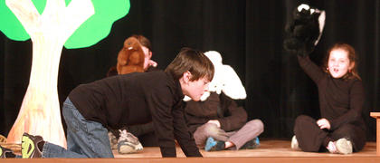 "Jackson Chapman (the tortoise) ""races"" to victory in ""The Tortoise and the Hare""."