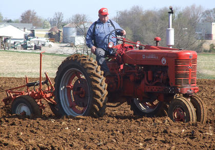 The annual Plow Day was held April 12 at Goodin View Farms. Jodie Hughes drives a Farmall Super M during Saturday's Plow Day.