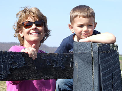 Braxton Lee, 4, enjoys watching the tractors with his grandmother, Mary Sue Lee.