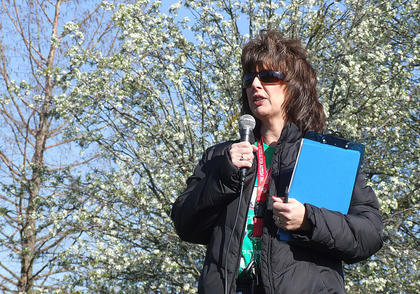 Lisa Nally-Martin addresses the crowd at the start of the Working the Puzzle for Autism Walk. Hundreds of people participated in the event April 13 at Graham Memorial Park.