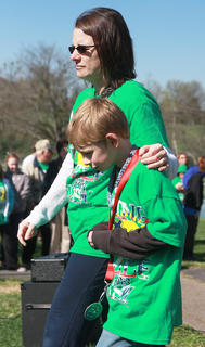 Laura Essex and her son Peyton, 9, of Loretto return to the audience after she presented Peyton with his medal.