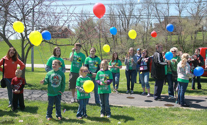 As the event drew to a close, participants gathered for a balloon release.