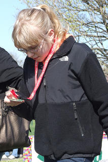 McKenzie Gadberry  examines her medal. Medals were presented to each child in attendance who has been diagnosed with an autism spectrum disorder.
