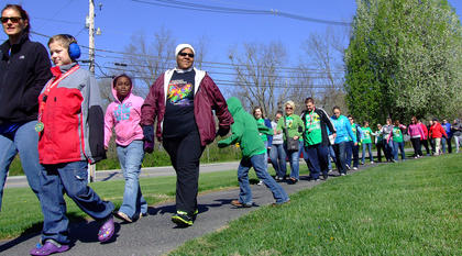 To kick off the Working the Puzzle for Autism Walk, hundreds of people took part in a ceremonial lap around the park.