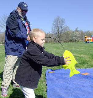 Layne Ramey takes a more hands-on approach after he reeled in a fish with some help from Shelton Young.