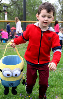 Carter Ryne Overstreet, 4, runs with his super cool Minion Easter basket to find Easter eggs.